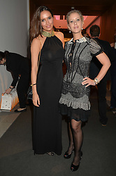 Left to right, SASHA VOLKOVA and ELISABETH ESTEVE at She Inspires Art in aid of Women for Women International's work, held at Bonham's, 101 New Bond Street, London on 16th September 2015.