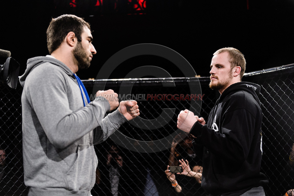 """LONDON, ENGLAND, MARCH 5, 2014: Omari Akhmedov and Gunnar Nelson face off at the media open work-out sessions for """"UFC Fight Night: Gustafsson vs. Manuwa"""" inside One Embankment in London, England (Martin McNeil for ESPN)"""