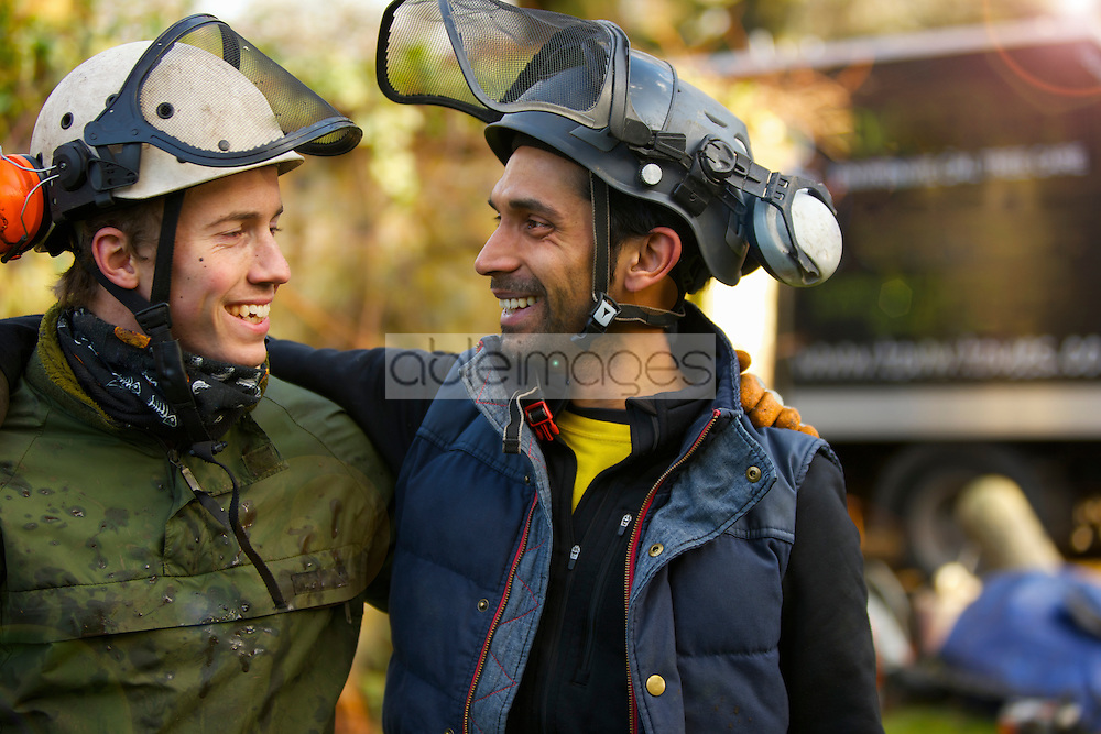 Two Tree Surgeons Laughing and Looking at Each Other