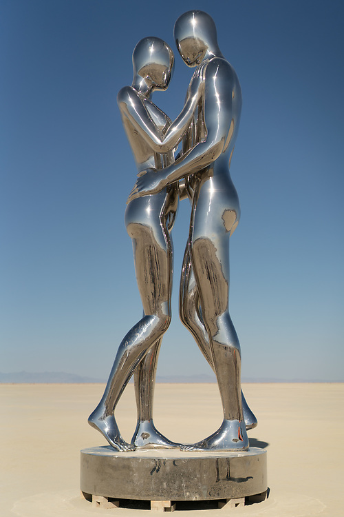 In Every Lifetime I Will Find You by: Michael Benisty, Love and Unity from: Brooklyn, NY year: 2018<br /> <br /> A sculptural representation of Male and Female holding one another in a symbolic and universal position of caring in a display of Love and Unity. Measuring 25 feet tall and made out of mirror polished stainless steel.
