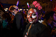 New York, NY - 31 October 2015. A smiling African-American woman, made up to look as though she's streaked in blood, gives a big smile in the annual Greenwich Village Halloween Parade.