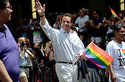 New York Governor Andrew Cuomo waving to spectators at the annual Pride Parade in New York City.  Gay rights supporters had much to celebrate at this year's New York City Pride Parade, which came on the heels of the Supreme Court's decision to overturn DOMA (Defense of Marriage Act).  The ruling extends federal benefits to same-sex couples who are married in states that recognize gay marriage.