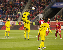 STYLEPREPENDJonathan Mensah (4) of Columbus Crew SC controls air ball during 2nd leg MLS Cup Eastern Conference semifinal game against Red Bulls at Red Bul Arena Red Bulls won 3 - 0 agregate 3 - 1 and progessed to final  (Credit Image: © Lev Radin/Pacific Press via ZUMA Wire)