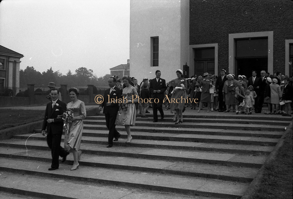 08/10/1959<br /> 10/08/1959<br /> 08 October 1959<br /> Wedding:Kenny - Colgan  (Muriel? and Tommy) at Church of St. Vincent de Paul, Griffith Avenue and the Grand Hotel, Malahide, Dublin. The couple  lead the party outside the church after the wedding service.