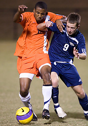 Virginia Cavaliers F/MF Ross LaBauex (8) battles with Mount Saint Mary's Mountaineers F Pfau Berry (9) for the ball.  The #4 ranked Virginia Cavaliers men's soccer team defeated the Mount Saint Mary's Mountaineers 3-0 at Klockner Stadium in Charlottesville, VA on September 25, 2007.