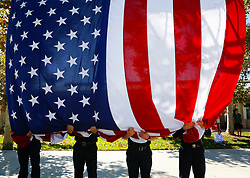 September 11, 2017 - San Diego, California, UU.S.- Fire fighters from San Diego County Fire, Cal Fire held a large U.S. flag as the ladder truck lifted the flag at the end of the ceremony following the 16th Anniversary Ceremony at Grossmont College.  Left-to-right, Cpt. RYAN MITCHELL, STEVEN HAY, CODY CORNETTE and RICKY HARDY. (Credit Image: © Nelvin C. Cepeda/San Diego Union-Tribune via ZUMA Wire)