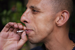 Portrait of a man smoking; Community Care Project user,