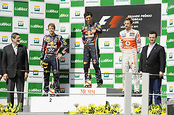 27.11.2011, Autodromo Jose Carlos Pace, Sao Paulo, BRA, F1, Grosser Preis von Brasilien, im Bild Podium - Sebastian Vettel (GER), Red Bull Racing - Mark Webber (AUS), Red Bull Racing - Jenson Button (GBR), McLaren F1 Team // during the Formula One Championships 2011 Grand Prix of Brazil held at the Autodromo Jose Carlos Pace, Sao Paulo, Brazil on 2011/11/27. EXPA Pictures © 2011, PhotoCredit: EXPA/ nph/ Mathi  ..***** ATTENTION - OUT OF GER, CRO *****