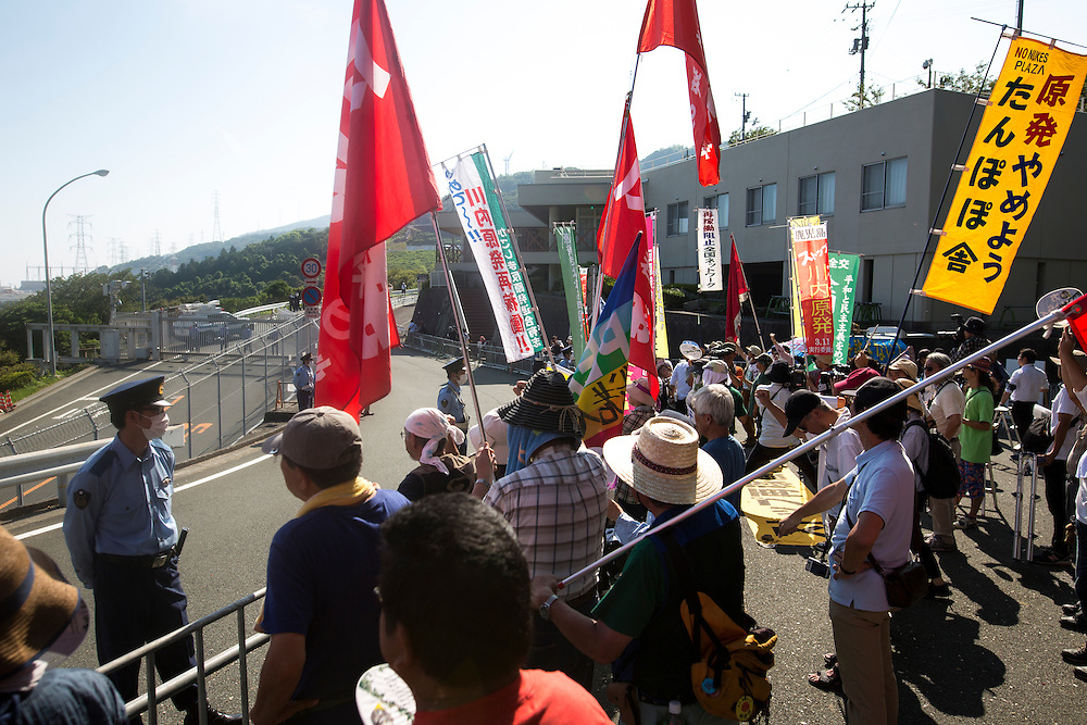 EHIME, JAPAN - AUGUST 12 : Anti-nuclear protesters gather in front of Ikata Nuclear Power Plant to protest against the restarting of a nuclear reactor on August 12, 2016 in Ikata, Ehime prefecture, northwestern Shikoku, Japan. The Shikoku Electric Power Company restarted the plant's No.3 reactor at around 9 AM on Friday. It is the third plant to go online under new regulations issued after the Fukushima Daiichi nuclear disaster. (Photo by Richard Atrero de Guzman/NURPhoto)