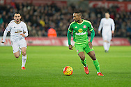 Jermain Defoe of Sunderland pursued by Leon Britton of Swansea during the Barclays Premier League match between Swansea City and Sunderland at the Liberty Stadium, Swansea, Wales on 13 January 2016. Photo by Mark Hawkins.