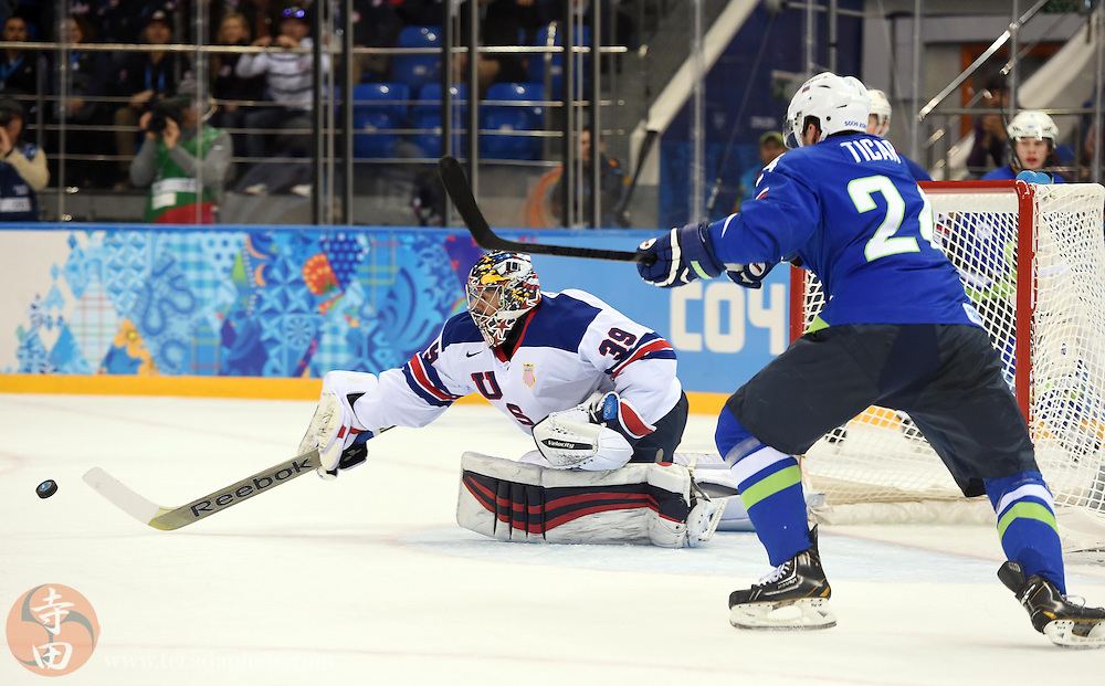 Feb 16, 2014; Sochi, RUSSIA; USA goalie Ryan Miller (39) reaches for the puck as Slovenia forward Rok Ticar (24) looks on in a men's ice hockey preliminary round game during the Sochi 2014 Olympic Winter Games at Shayba Arena.