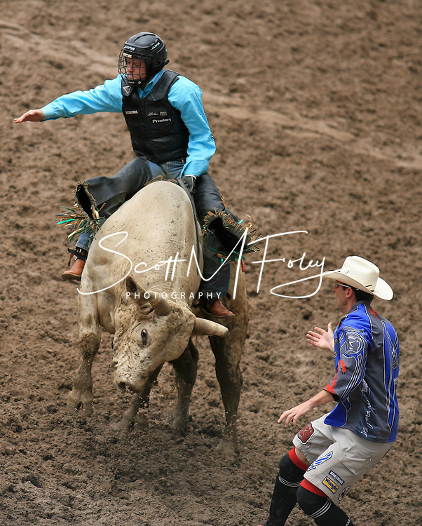 Bull Rider Billy Joe Schumacher riding on 113 Eric Henderson BK and Bull Fighter and Air Force Captain Jeremy Sparks, 27 July 2007, Cheyenne Frontier Days