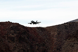 Boeing EA-18G XE-502 Growler of the US Navy's VX-9 Vampires squadron flies low level through the Star Wars Canyon, Jedi Transition, Sidewinder course, Death Valley National Park, California, United States of America