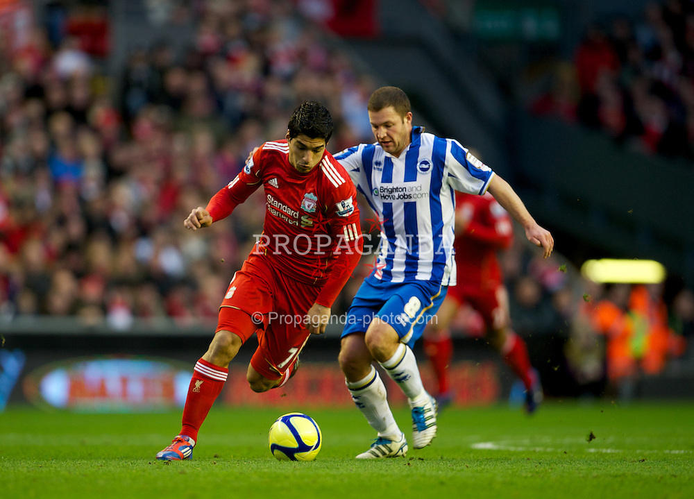 LIVERPOOL, ENGLAND - Saturday, February 19, 2012: Liverpool's Luis Alberto Suarez Diaz in action against Brighton & Hove Albion's Alan Navarro during the FA Cup 5th Round match at Anfield. (Pic by David Rawcliffe/Propaganda)