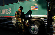 As troops load the bus Isaiah Pansoy wipes the tears from his eyes as he leaves his wife Elaine and 14 month old baby. The Guard's 2668th Transportation Company left for duty at 8 o'clock Wednesday morning form the National Guard located on Meadowview Rd.