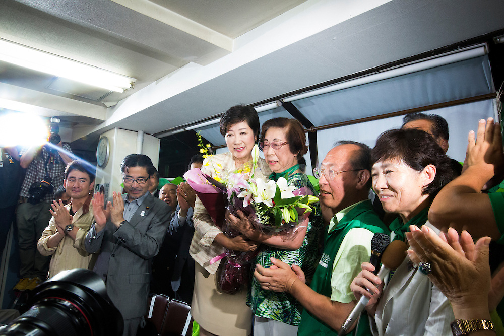TOKYO, JAPAN - JULY 31 : Yuriko Koike, newly elected governor of Tokyo, center, takes photo during a news conference after winning the Tokyo gubernatorial election at her office in Tokyo, Japan, on Sunday, July 31, 2016. Yuriko Koike a Liberal Democratic Party lawmaker and former defense minister is the first women to be elected as a Governor of Tokyo. (Photo: Richard Atrero de Guzman/NURPhoto)