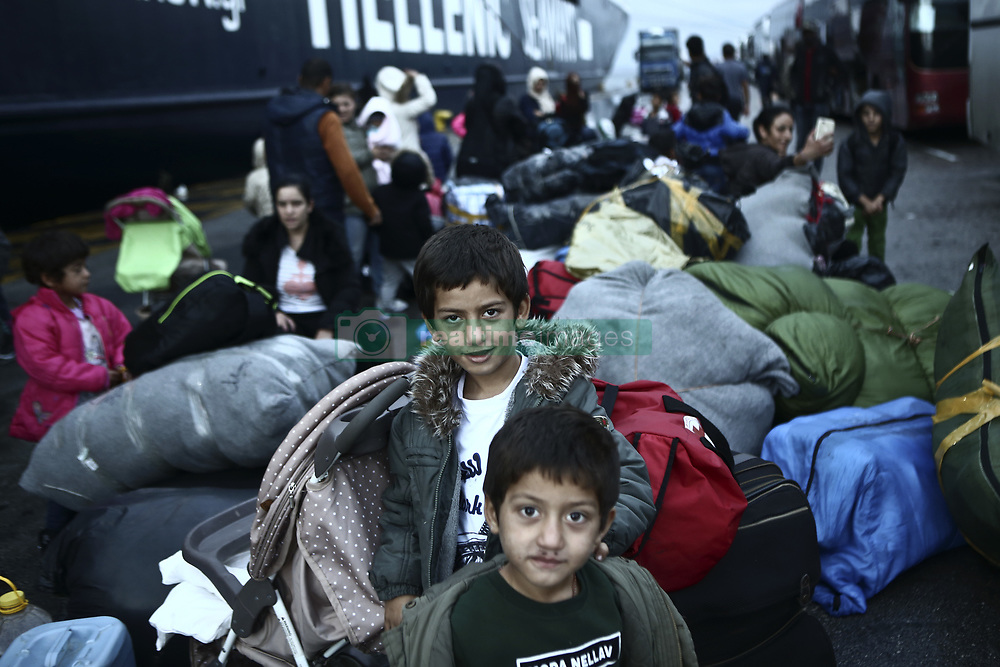 September 29, 2018 - Piraeus, Attica, Greece - Refugees and migrants are heading to buses at the port of Piraeus, near Athens, Greece. More than 400 refugees and migrants of different nationalities from the Moria hotspot on Lesvos Island are transferred to the main land in an effort to relieve the overcrowding camp which according the environmental and health inspectors from Lesvos public health directorate, is unsuitable and dangerous for public health and the environment. (Credit Image: © Panayotis Tzamaros/NurPhoto/ZUMA Press)