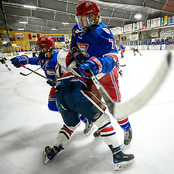 COCHRANE, ON - MAY 1: Jack Lyons #72 of the Oakville Blades battles with Ryan Porter #17 of the Cobourg Cougars on May 1, 2019 at Tim Horton Events Centre in Cochrane, Ontario, Canada.<br /> (Photo by Christian Bender / OJHL Images)