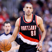 12 February 2014: Portland Trail Blazers small forward Nicolas Batum (88) brings the ball up court during the Los Angeles Clippers 122-117 victory over the Portland Trail Blazers at the Staples Center, Los Angeles, California, USA.