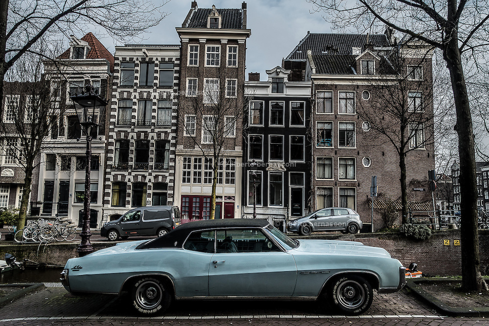 Amsterdam, vintage car parked in central Amsterdam by the canal