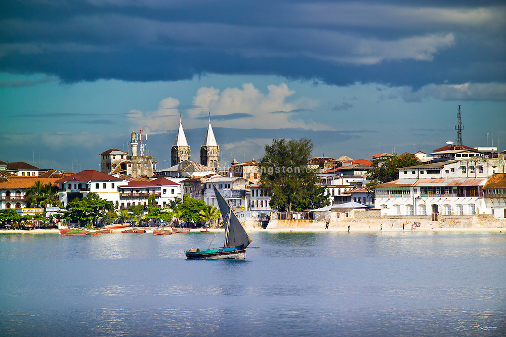 A view from the water of Stone Town, Zanzibar, Tanzania.  A tourist attraction and UNESCO World Heritage Site, known for its many cultural, historical and architectural influences.