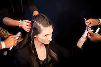 A model gets her hair and nails ready, backstage for the Brazilian brand, Neon, at São Paulo Fashion Week for Summer Season 2013/2014, at Bienal, in São Paulo, Brazil, on Wednesday, March 20, 2013.