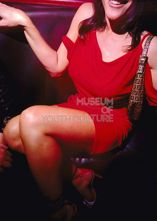 Woman in red dress with Fendi handbag at Club 144 London May 2002