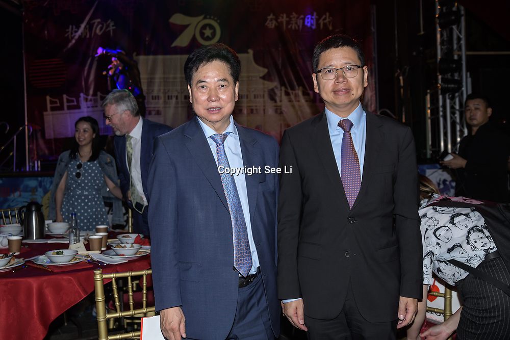Chu Ting Tang of London Chinatown Chinese  Association with Honourable  Chinese Minister Counsellor , Consular and Overseas Chinese Affairs Mr. Tong Xuejun (童学军) attend the Celebration of the Moon festival - The big feast for the chinese community and the 70th Anniversary of China at Chinatown Square on the 15th September 2019, London, UK.