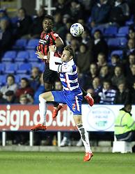 Brighton and Hove Albion's Kazenga LuaLua beats Reading's Chris Gunter - Photo mandatory by-line: Robbie Stephenson/JMP - Mobile: 07966 386802 - 10/03/2015 - SPORT - Football - Reading - Madejski Stadium - Reading v Brighton - Sky Bet Championship