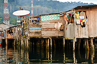 Satellite dish in a water village, Manokwari, West Papua, Indonesia. Manokwari is a small town on the north east coast of the Bird's Head Peninsula, West Papua, Indonesia.  Its harbour has many wrecks from WWII.
