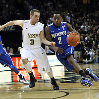 Memphis guard Antonio Barton (2) drives past Central Florida guard A.J. Rompza (3) during a Conference USA NCAA basketball game between the Memphis Tigers and the Central Florida Knights at the UCF Arena on February 9, 2011 in Orlando, Florida. Memphis won the game 63-62. (AP Photo: Alex Menendez)