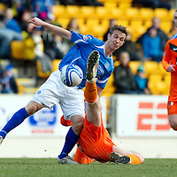 St Johnstone v Dundee United...11.02.12.. SPL<br /> Chris Millar gets a kick from Scott Robertson<br /> Picture by Graeme Hart.<br /> Copyright Perthshire Picture Agency<br /> Tel: 01738 623350  Mobile: 07990 594431