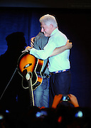 "LAURA FONG | Former U.S. President Bill Clinton embraces rocker Bruce Springsteen at a campaign rally for Barack Obama in Parma, Ohio, Thursday.  ""If Bill would have brought his sax then we would really have had a jam session"", Springsteen said after taking the stage to play to a crowd of 3,000."