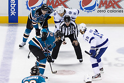 Dec 21, 2011; San Jose, CA, USA; NHL linesman Vaughan Rody (73) drops the puck on a face off to San Jose Sharks center Logan Couture (39) and Tampa Bay Lightning center Dominic Moore (19) during the first period at HP Pavilion. San Jose defeated Tampa Bay 7-2. Mandatory Credit: Jason O. Watson-US PRESSWIRE