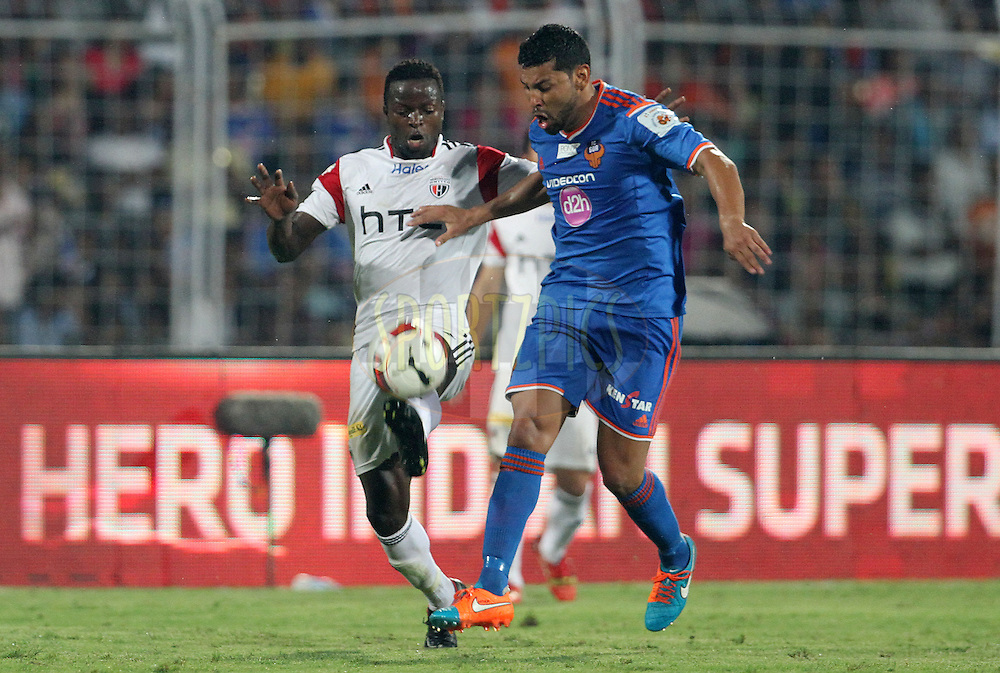 Isaac Chansa of NorthEast United FC and Andre Santos of FC Goa in action during match 46 of the Hero Indian Super League between FC Goa and North East United FC held at the Jawaharlal Nehru Stadium, Fatorda, India on the 1st December 2014.<br /> <br /> Photo by:  Vipin Pawar/ ISL/ SPORTZPICS