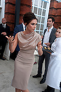 VICTORIA BECKHAM;, Alexandra Shulman, Editor of Vogue & Phil Popham, Managing Director of Land Rover<br /> host the 40th Anniversary of Range Rover. The Orangery at Kensington Palace. London. 1 July 2010. -DO NOT ARCHIVE-© Copyright Photograph by Dafydd Jones. 248 Clapham Rd. London SW9 0PZ. Tel 0207 820 0771. www.dafjones.com.