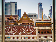 03 FEBRUARY 2015 - BANGKOK, THAILAND:  The skyline of Bangkok's financial district is framed by the roofline of Wat Hua Lamphong in Bangkok. After months of relative calm following the May 2014 coup, tensions are increasing in Bangkok. The military backed junta has threatened to crack down on anyone who opposes the government. Relations with the United States have deteriorated after Daniel Russel, the US Assistant Secretary of State for Asian and Pacific Affairs, said that normalization of relations between Thailand and the US would depend on the restoration of a credible democratically elected government in Thailand.        PHOTO BY JACK KURTZ
