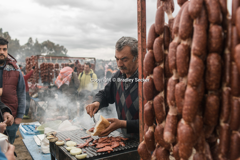 TURKEY, Izmir, Selçuk. A vendor sells camel meat sausage sandwiches around the competiting stadium of the 35th annual Selcuk Camel Wrestling competition, near Izmir, Turkey