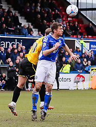 Bristol Rovers' Matt Taylor challenges for a header - Photo mandatory by-line: Neil Brookman/JMP - Mobile: 07966 386802 - 28/03/2015 - SPORT - Football - Macclesfield - Moss Rose - Macclesfield Town v Bristol Rovers - Vanarama Football Conference
