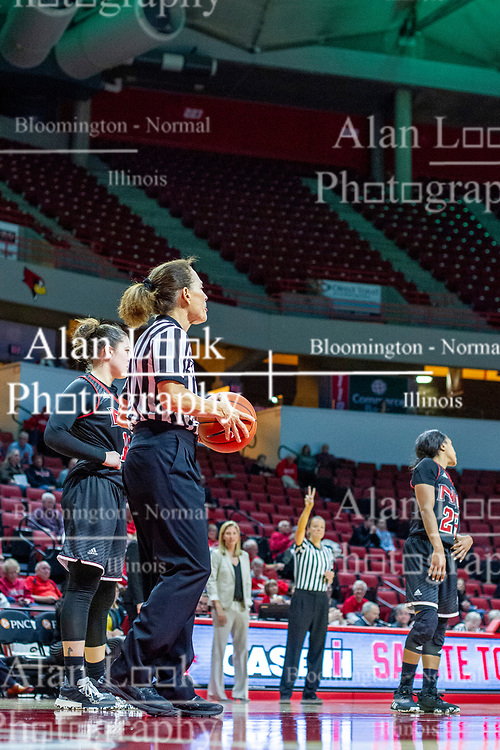 NORMAL, IL - November 20:  Referee Barb Smith handles a free throw situation with Molly Caldwell in the background directing traffic during a college women's basketball game between the ISU Redbirds and the Huskies of Northern Illinois November 20 2019 at Redbird Arena in Normal, IL. (Photo by Alan Look)