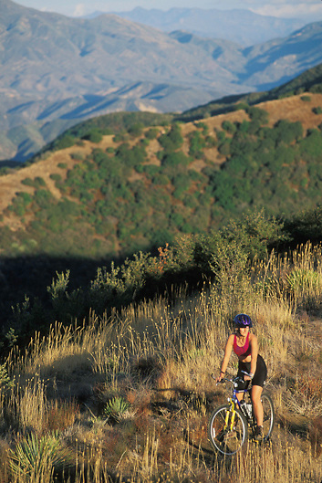 Woman rides Mountain Bike on Gibraltor Trail in Santa Barbara California