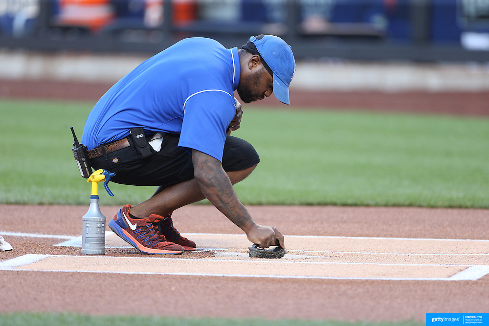 NEW YORK, NEW YORK - July 27: Ground staff prepare home plate before the St. Louis Cardinals Vs New York Mets regular season MLB game at Citi Field on July 27, 2016 in New York City. (Photo by Tim Clayton/Corbis via Getty Images)