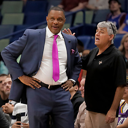 Apr 3, 2019; New Orleans, LA, USA;  A fan talks with New Orleans Pelicans head coach Alvin Gentry near the end of the fourth quarter against the Charlotte Hornets at the Smoothie King Center. Mandatory Credit: Derick E. Hingle-USA TODAY Sports