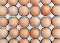 Full-Frame shot of brown eggs arranged in carton