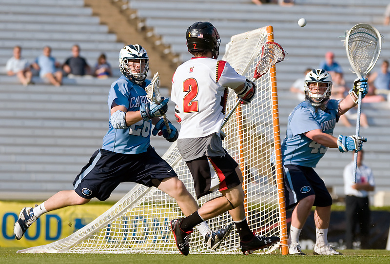 24 April 2009:Marylands senior middie #2 Dan Groot passes ball inside.