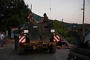 KFOR patrolling freely before the road is shut the next day...Serbian roadblocks along the main Pristina-Leposavic road in the village of Rudare, near Kosovska Mitrovica, Kosovo..Border crisis, July 2011
