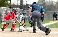 Cantins Zachary Cormier puts the tag on Legions Matt Westcott as he looks to the umpire for the call during Laconia Little League major league game Tuesday evening.  (Karen Bobotas/for the Laconia Daily Sun)