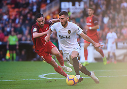 December 8, 2018 - Valencia, U.S. - VALENCIA, SPAIN - DECEMBER 08: Sarabia, midfielder of Sevilla FC competes for the ball with Gaya, defender of Valencia CF during to the La Liga game between Valencia CF and Sevilla FC on December 08, 2018, at Mestalla Stadium in Valencia, Spain. (Photo by Carlos Sanchez Martinez/Icon Sportswire) (Credit Image: © Carlos Sanchez Martinez/Icon SMI via ZUMA Press)