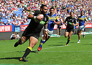 Ben Murdoch-Masila of Warrington Wolves break through the Leeds defence before scoring the fourth try against Leeds Rhinos during the Ladbrokes Challenge Cup Semi Final match at the Macron Stadium Stadium, Bolton.<br /> Picture by Michael Sedgwick/Focus Images Ltd +44 7900 363072<br /> 05/08/2018