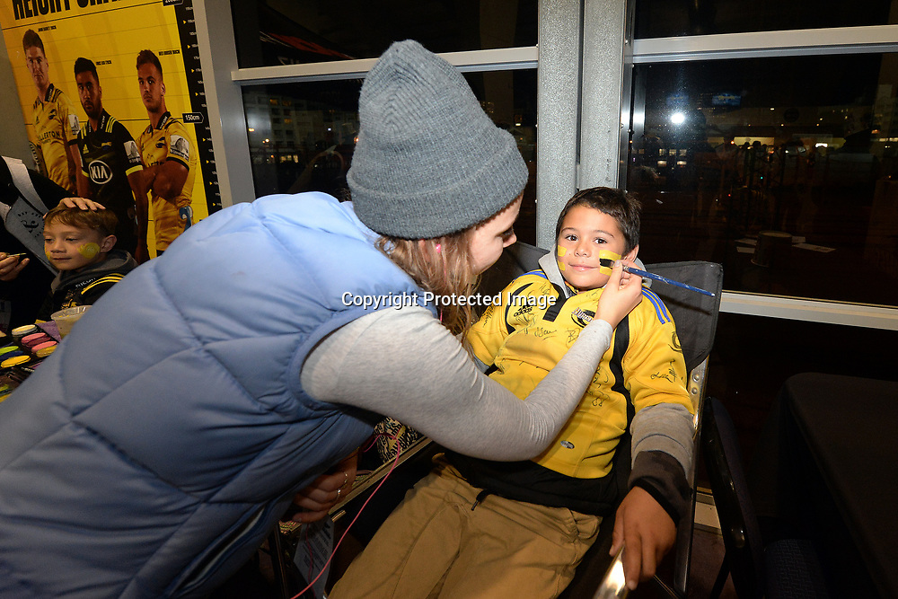 Young Fans getting their face painted at the concourse during the Super Rugby match between Hurricanes v Chiefs, Westpac Stadium, Wellington, Friday 13th April 2018. Copyright Photo: Raghavan Venugopal / www.photosport.nz
